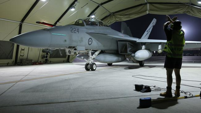 Mission complete ... A Super Hornet returns to base after the first combat flight, on Sunday.