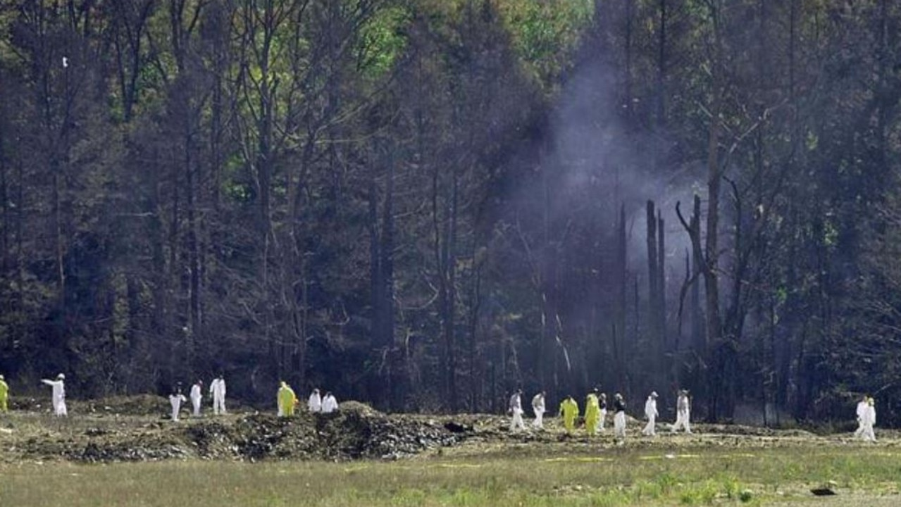 Investigative personnel search the crash site of United Airlines Flight 93 in Shanksville, Pennsylvania. Picture: AFP/David Maxwell