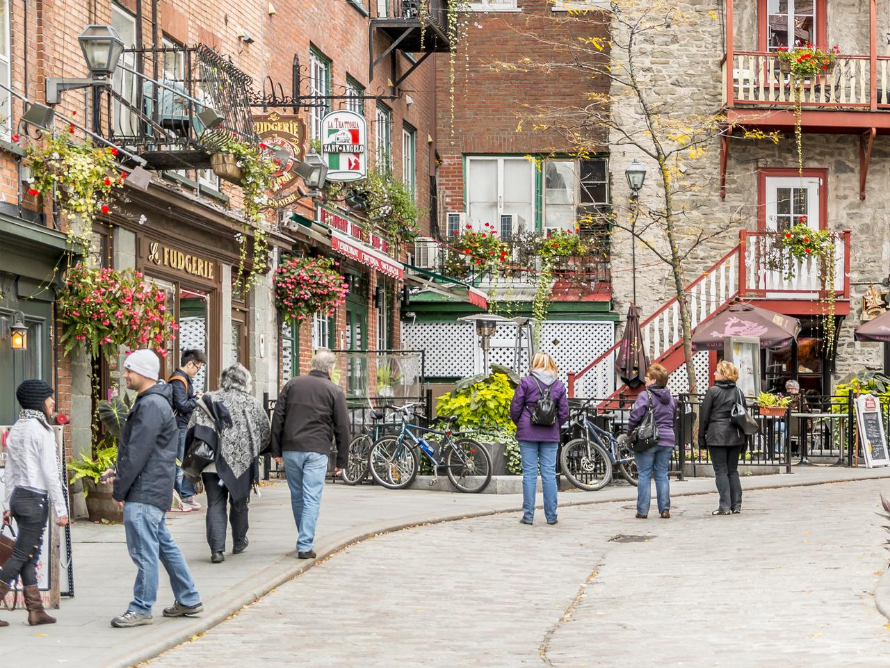 Quebec City, Canada - October 6, 2013: Shoppers strolling along Rue du Cul de Sac in the Quartier Petit Champlain in old town Quebec City.