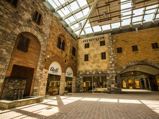 THE OUTLET VILLAGE Not all of us have thousands of dollars to drop on a Fendi bag, so it's no surprise that the Outlet Village in Dubai is hugely popular with tourists. It's designed to look like a European plaza and there are plenty of big brand names here — Armani, Michael Kors, Coach — at bargain prices. There is also kids' wear, footwear and sportswear up for grabs. Picture: Dubai Tourism