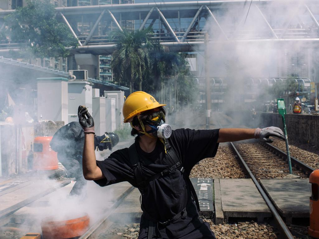 A protester throws a stone towards police outside Tin Shui Wai police station during a protest on August 5 in Hong Kong. Picture: Billy H.C. Kwok/Getty Images