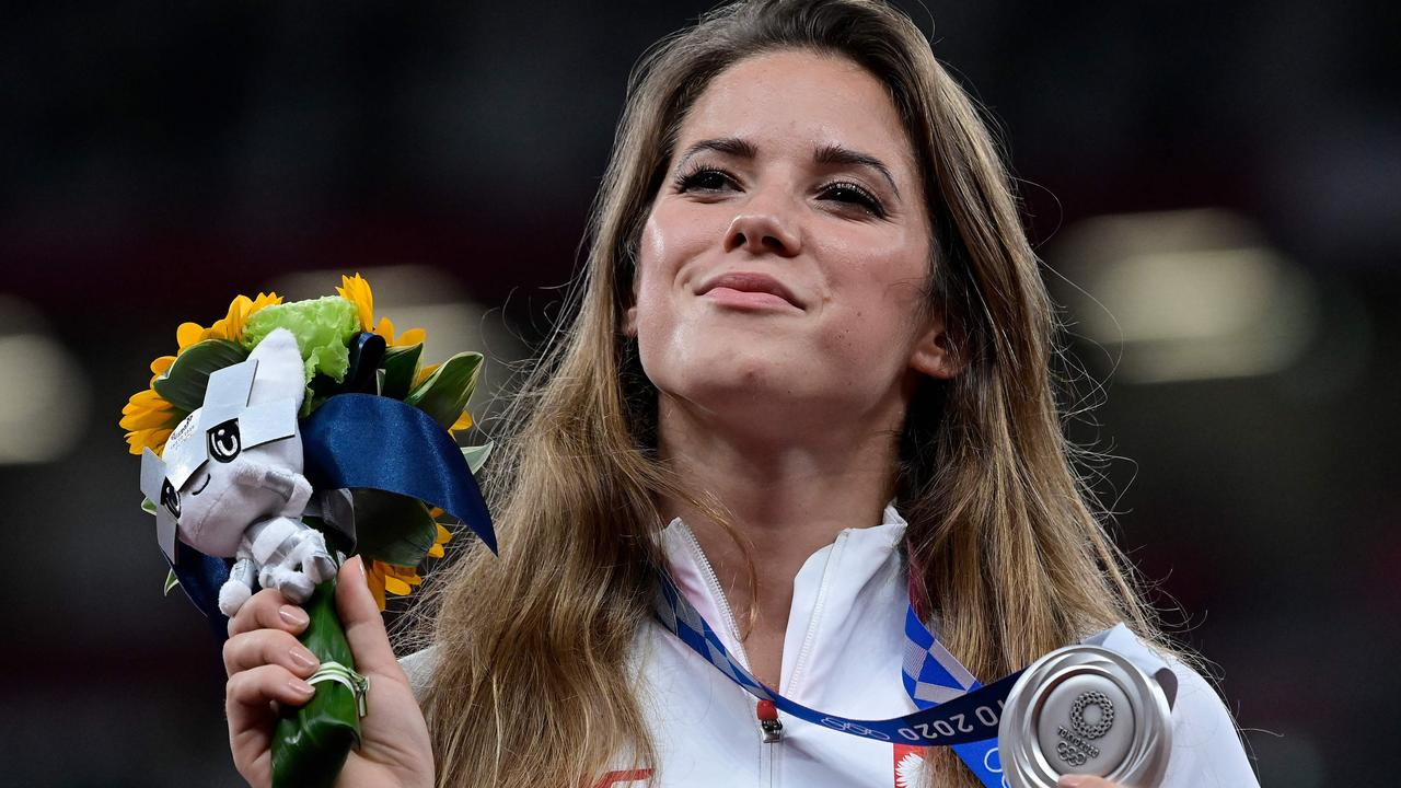 Poland's Maria Andrejczyk celebrates on the podium after claiming the silver medal in the women's javelin at the Tokyo Olympic Games. Picture: AFP