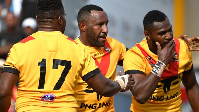 Papua New Guinea's Enock Maki (right) celebrates after scoring a try.