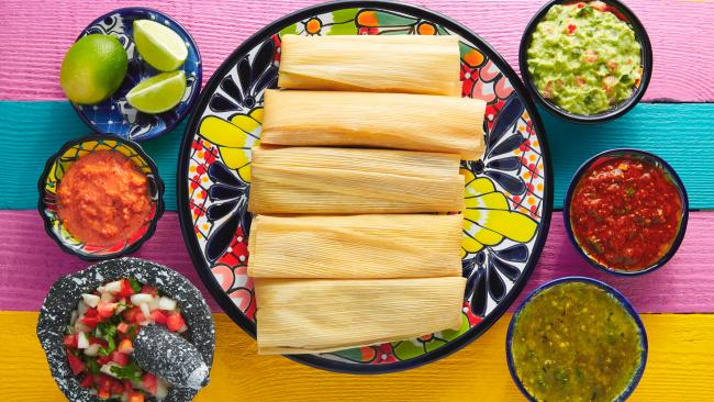 3/15Tamales - Mexico and Costa RicaEaten throughout the Christmas period - which for Mexicans, runs December 12 to January 6 - tamales make for a delicious holiday package. Meat like beef, chicken and fish are wrapped in plantain or corn leaves with cheese and/or veggies before being steamed and consumed. The Costa Rican version is a little different. Instead of corn leaves, the tamales are wrapped in banana leaves, with an interior consisting of corn or maize dough, rice, pork, vegetables and potatoes.