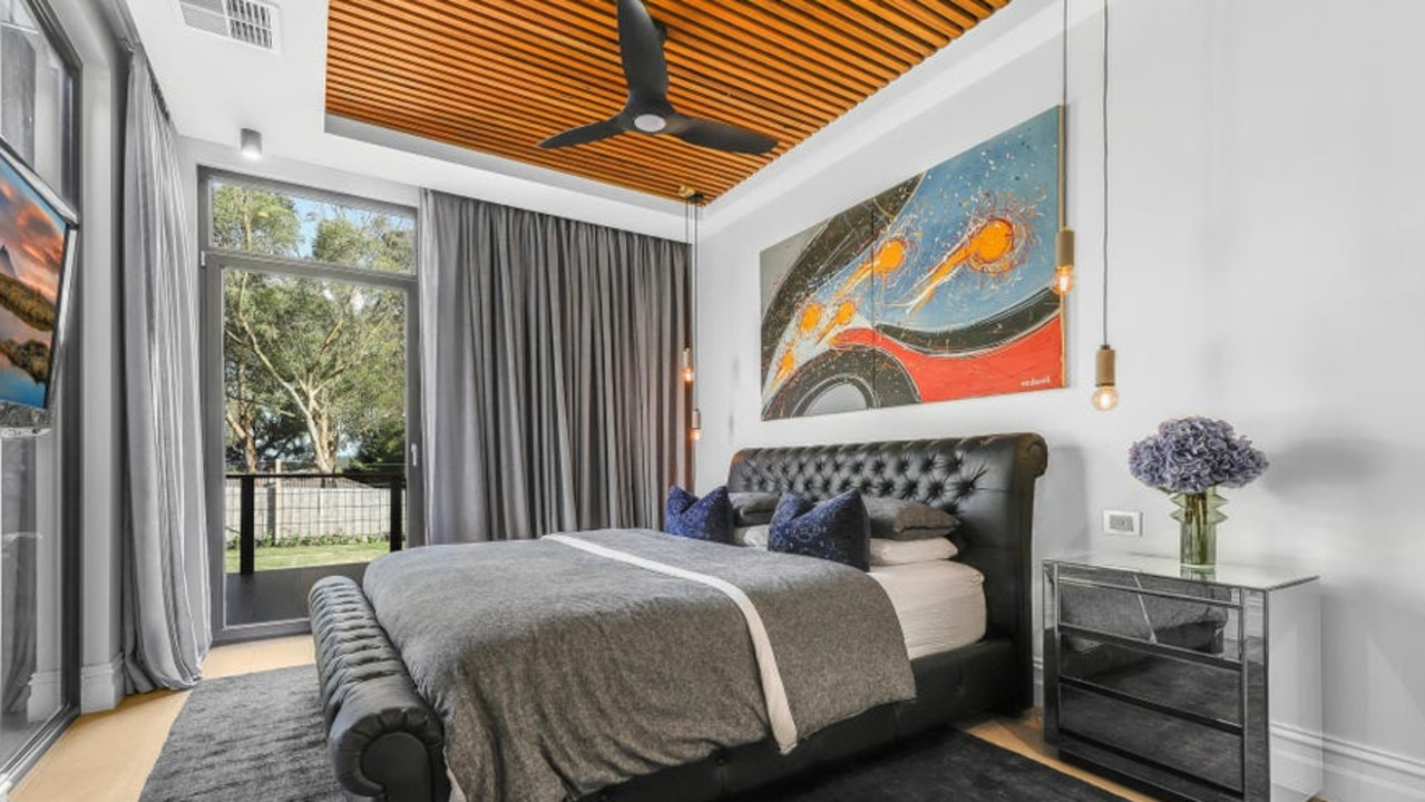 The main bedroom has a striking feature ceiling.