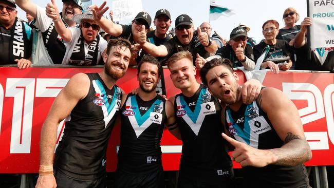 Charlie Dixon, Travis Boak, Ollie Wines and Chad Wingard celebrate the win. Picture: Getty
