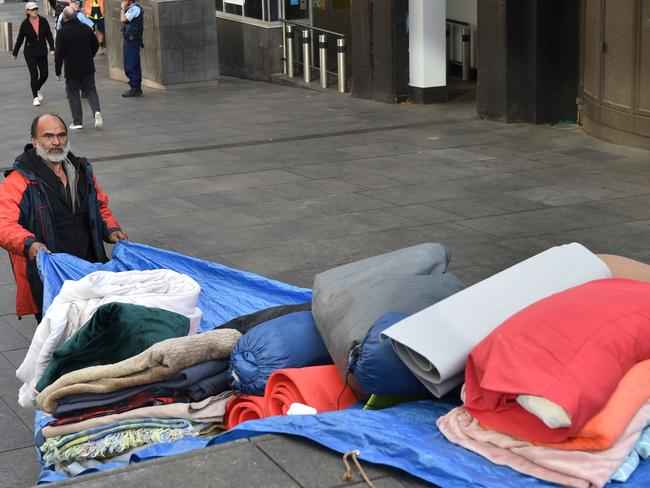 Lanz Priestley, who has been dubbed the 'mayor of tent city', packs up his belongings in Martin Place on Friday. Picture: AFP / Peter Parks