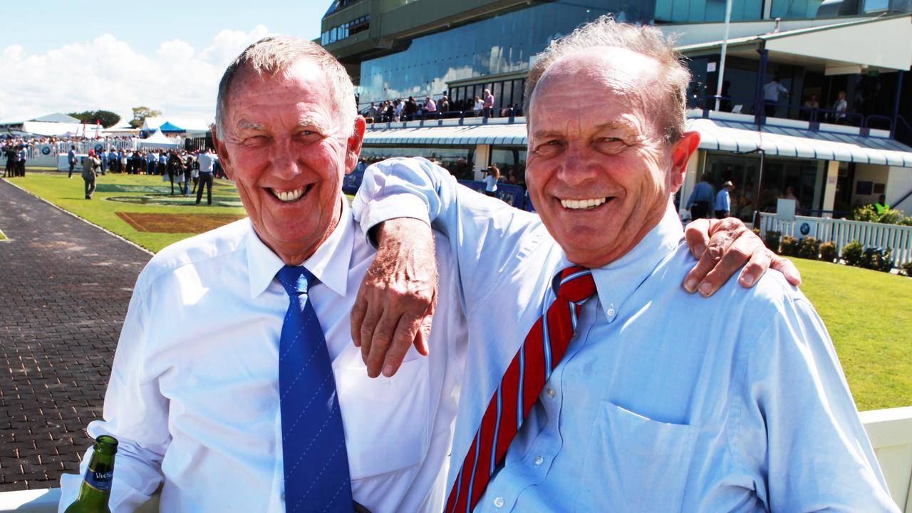 Businessmen John Singleton (L) and Gerry Harvey during the Magic Millions event at the Gold Coast Turf Club in Queensland.