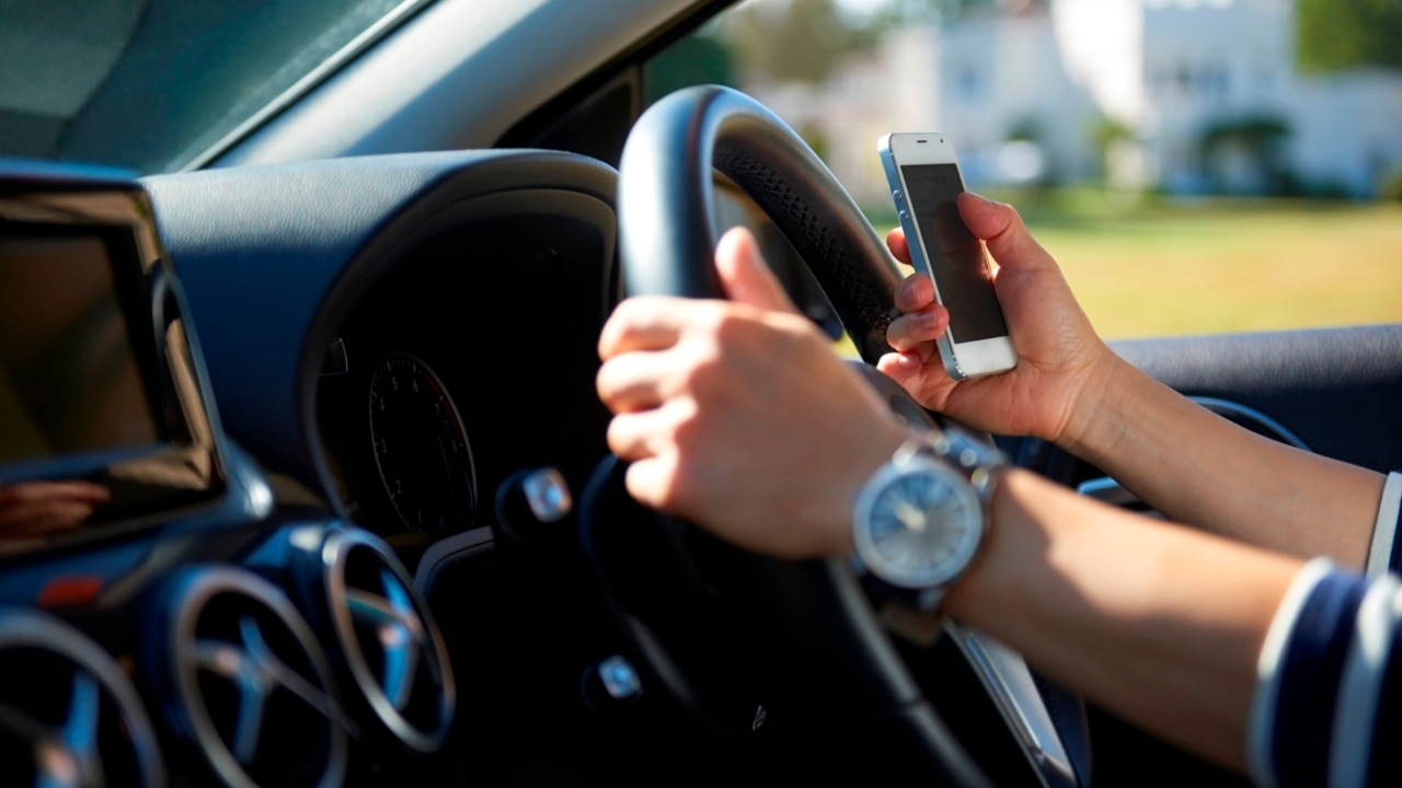 Queensland drivers prioritise mobile phones over their lives: report