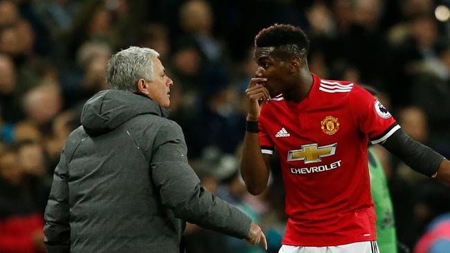 Manchester United's Portuguese manager Jose Mourinho (L) talks with Paul Pogba (R)