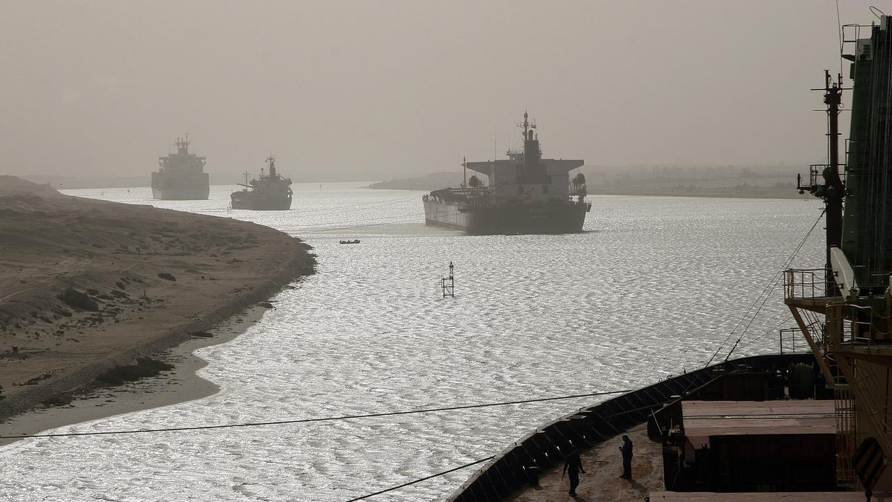This image shows another container ship that ran aground in the Suez Canal back in April 2006, sparking similar chaos. Picture: AFP
