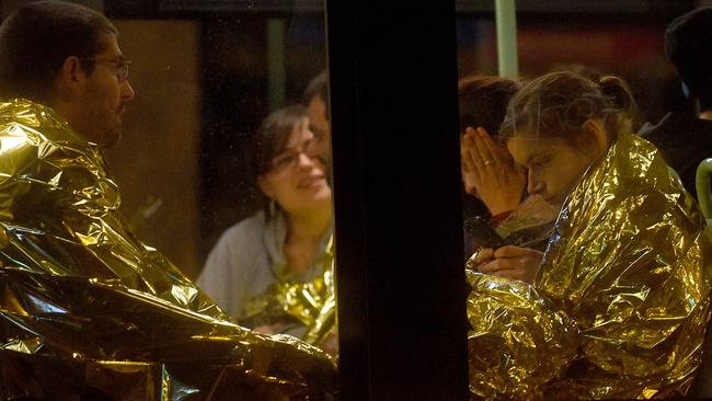 Survivors sit on a bus after gunfire in the Bataclan concert hall. Photo by Antoine Antoniol/Getty Images