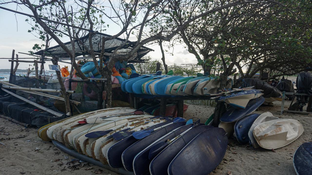 A kayak rental for tourism seen closed at Mertasari Beach,