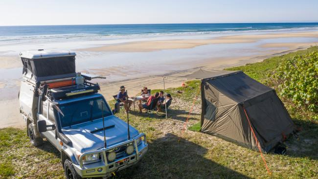 5/10Double Island Point The best beach camping on the Sunshine Coast can be found amongst the dunes of Teewah Beach, just before Double Island Point in the Cooloola Section of the Great Sandy National Park. You'll need a 4WD to get there, with a short ferry crossing to Noosa North Shore the kick-off to an adventurous drive 'up the beach' as locals call it. After you've set up camp, hike the 2.2km return track to the historic lighthouse and drive the Leisha Track to reach the coloured sands of Rainbow Beach. Take care when swimming; there are no lifeguard patrols here and drives need to be timed two hours either side of low tide. Arrange a beach driving permit online from Queensland Parks before you go. Picture: Tourism & Events Qld