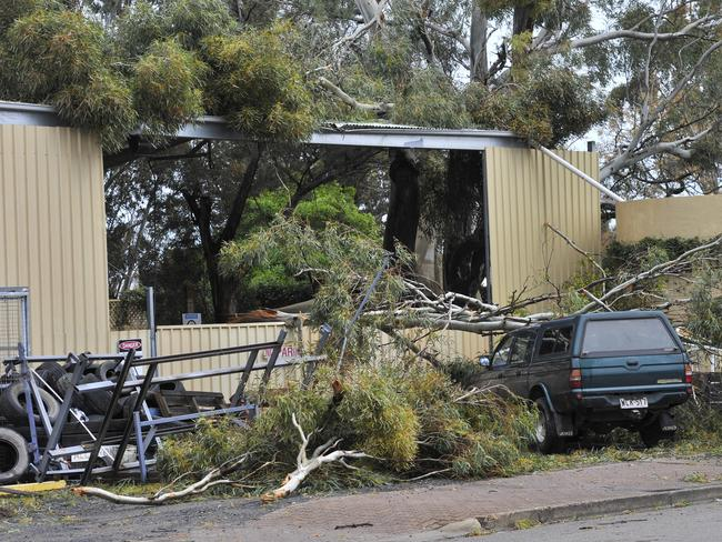 Roofs and parts of buildings were ripped off as the weather system attacked. Picture: David Mariuz
