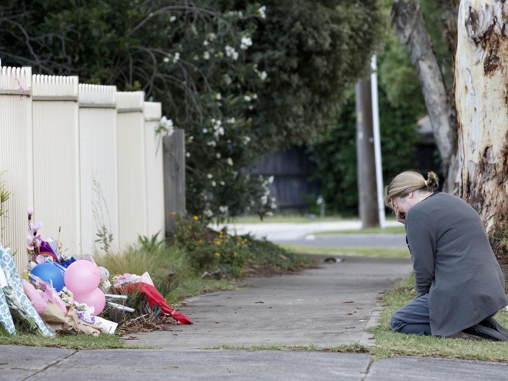 Mary D'Amico prays at the front of the home on Burgess Street in Tullamarine. Picture: David Geraghty