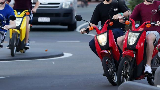 Schoolies have been accused of driving dangerously on the Gold Coast, including riding over roundabouts and too close together. Pictures: Nigel Hallett