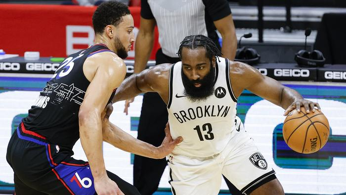 PHILADELPHIA, PENNSYLVANIA - FEBRUARY 06: James Harden #13 of the Brooklyn Nets drives against Ben Simmons #25 of the Philadelphia 76ers during the third quarter at Wells Fargo Center on February 06, 2021 in Philadelphia, Pennsylvania. NOTE TO USER: User expressly acknowledges and agrees that, by downloading and or using this photograph, User is consenting to the terms and conditions of the Getty Images License Agreement. (Photo by Tim Nwachukwu/Getty Images)
