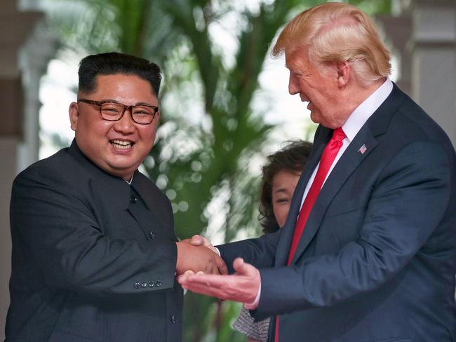 Kim Jong Un shakes hands with US President Donald Trump.