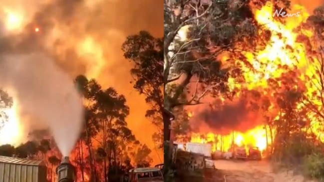 Firefighters confront roaring wall of flames near properties in blue mountains