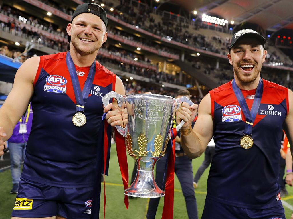 PERTH, AUSTRALIA - SEPTEMBER 25: Steven May of the Demons and Michael Hibberd of the Demons celebrate with the premiership cup during the 2021 Toyota AFL Grand Final match between the Melbourne Demons and the Western Bulldogs at Optus Stadium on September 25, 2021 in Perth, Australia. (Photo by Dylan Burns/AFL Photos via Getty Images)