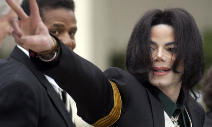 FILE - In this March 2, 2005, file photo, pop icon Michael Jackson waves to his supporters as he arrives for his child molestation trial at the Santa Barbara County Superior Court in Santa Maria, Calif. Tuesday, June 25, 2019, marks the tenth anniversary of Jackson's death. (AP Photo/Michael A. Mariant, File)
