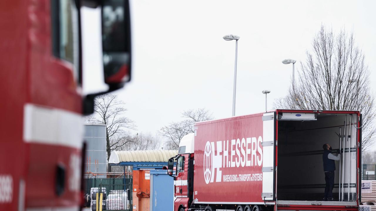 Trucks being loaded at a Pfizer factor, in Puurs, Belgium, where COVID-19 vaccines are being produced. Picture: Kenzo Tribouillard/AFP