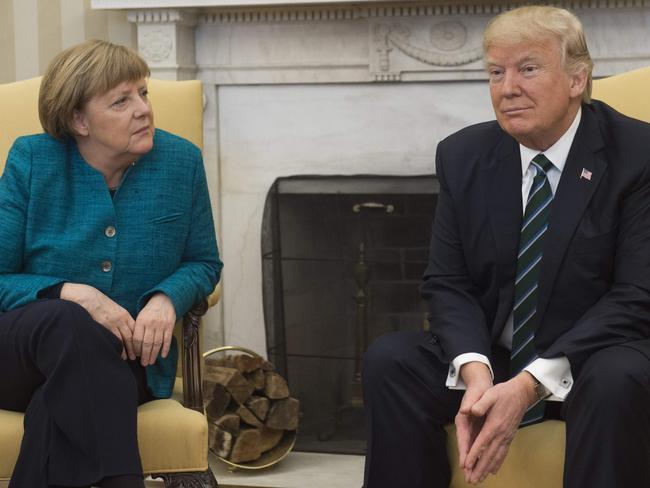 Donald Trump didn't hear Angela Merkel's request for a handshake, Sean Spicer said. Picture: Saul Loeb