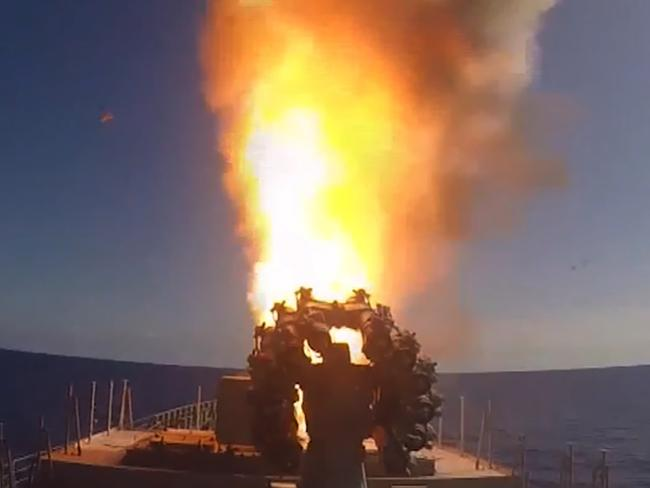 An image grab taken from a video footage made available on the Russian Defence Ministry shows cruise missiles being launched in the eastern Mediterranean off the Syrian coast.  Picture:  AFP