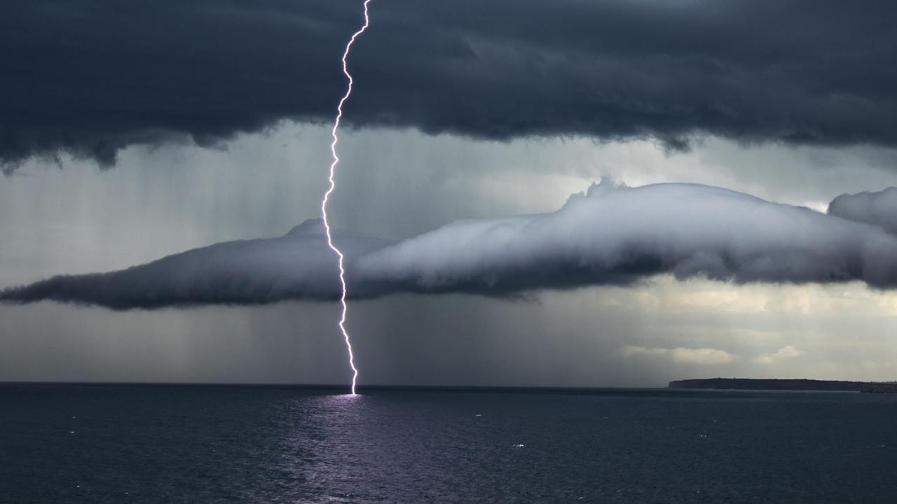 A lightning strike hits the water off Bondi on Friday. Picture: Daniel Shaw