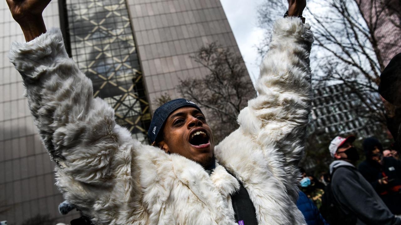 A man celebrates as the verdict is announced. Picture: Chandan Khanna / AFP