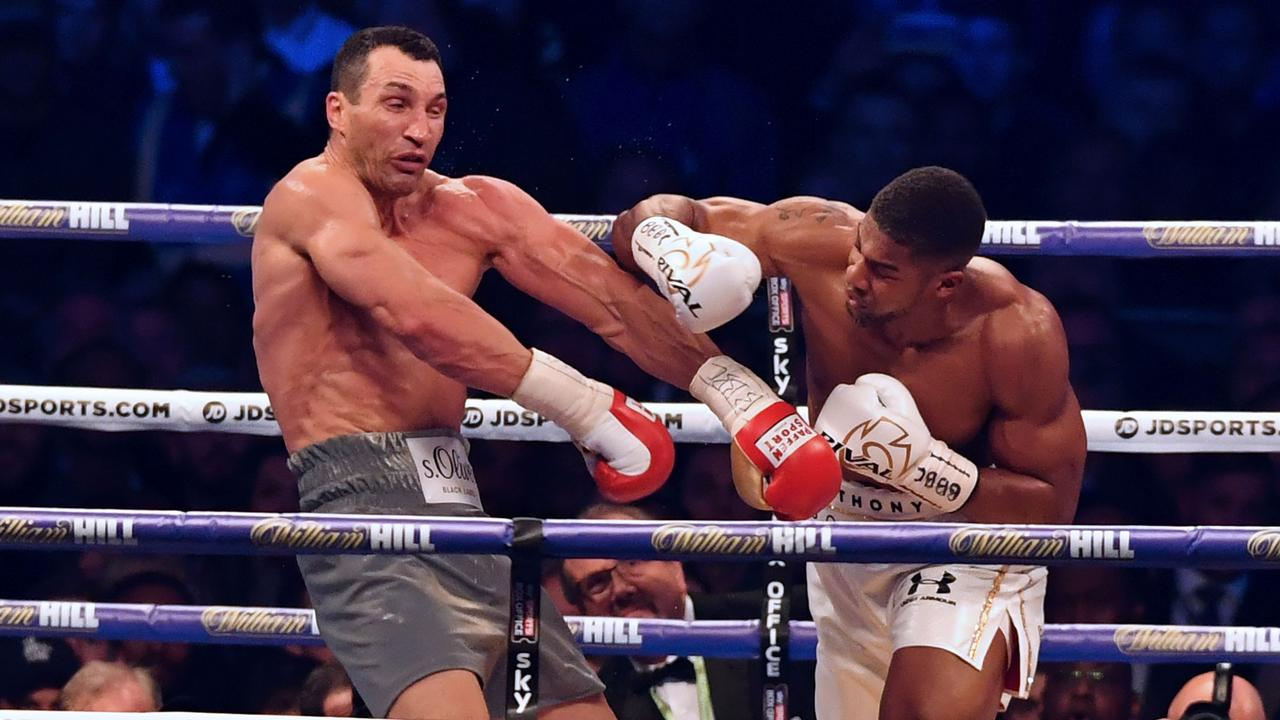 Anthony Joshua punches Wladimir Klitschko during the fourth round of their world title fight. Picture: AFP PHOTO/Ben STANSALL