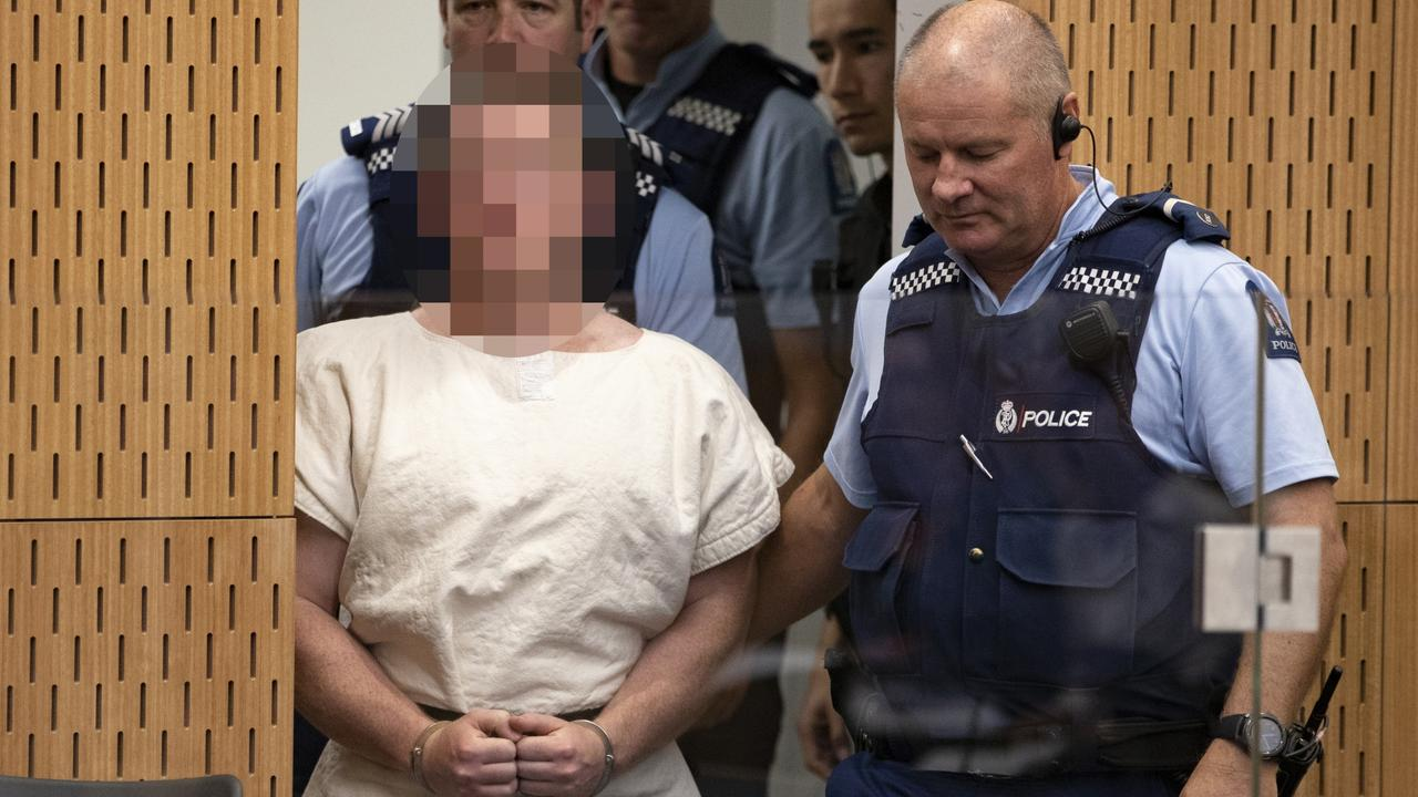 Brenton Tarrant is lead into the dock for his appearance. Picture: Mark Mitchell/NZ Herald