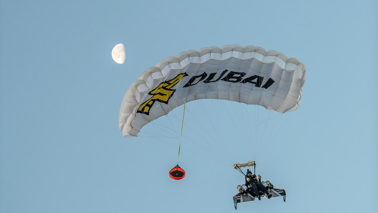 He parachuted back to Earth when the flight finished. Picture: EXPO 2020/AFP