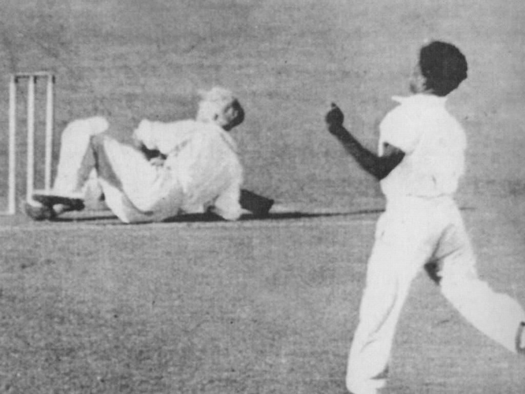 Eddie Gilbert knocks Sir Donald Bradman to the ground at the Gabba in Brisbane in 1931.