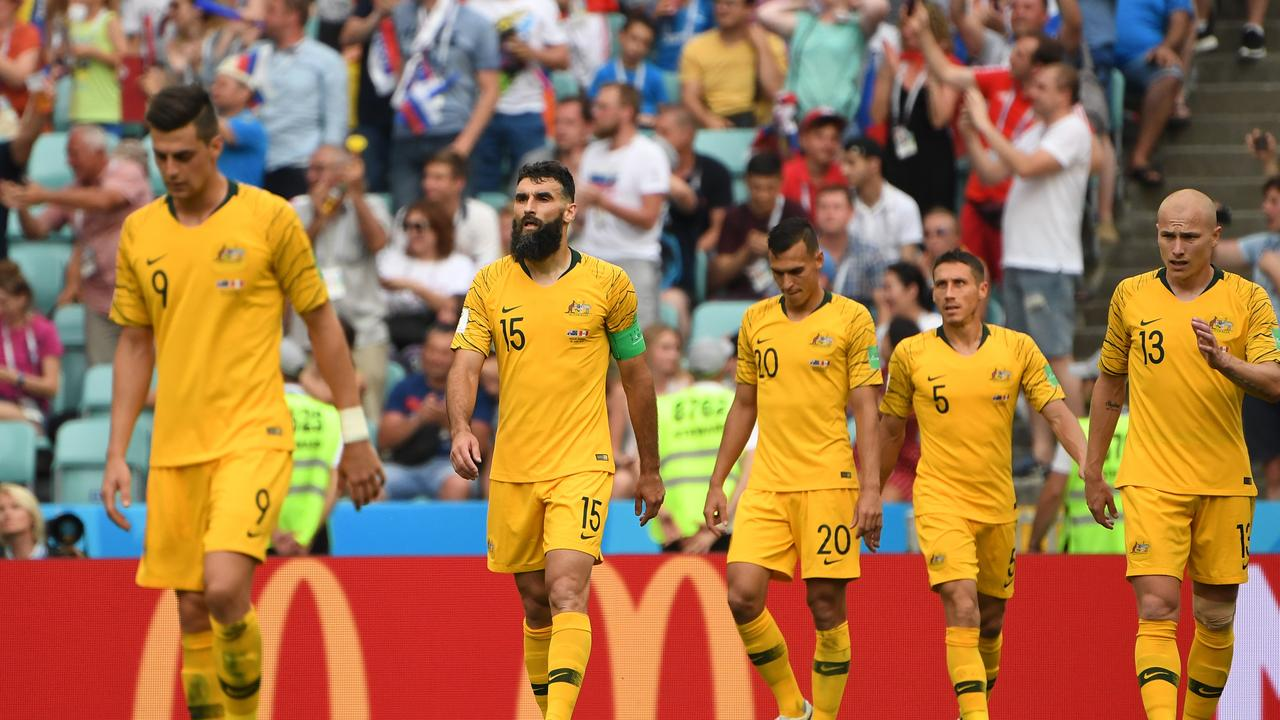 A dejected Australia after Peru scored their second goal.