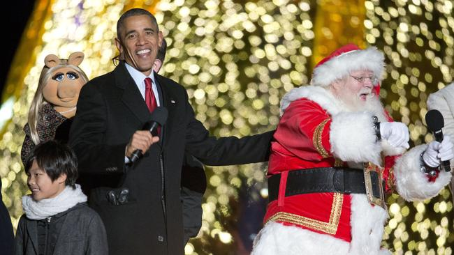 Festive ... President Barack Obama with Santa Claus at the National Christmas Tree Lighting ceremony in Washington on December 3, 2015. Picture: AP Photo/Pablo Martinez Monsivais