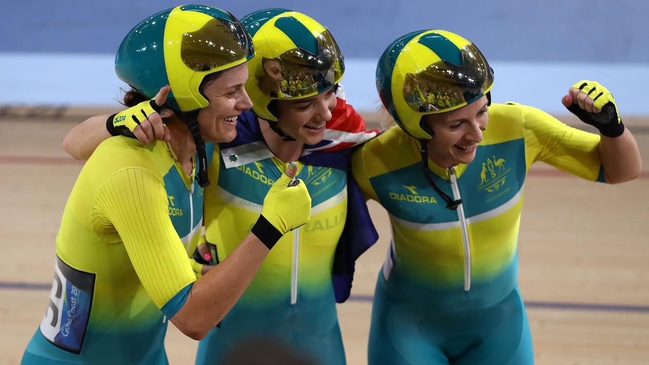 Amy Cure celebrates with teammates Annette Edmondson and Ashlee Ankudinoff of Australia after winning the women's scratch race.