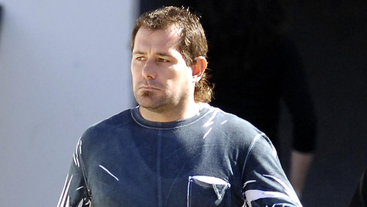 Ex-Coffin Cheater Troy Mercanti leaves Curtin House on his way to court.