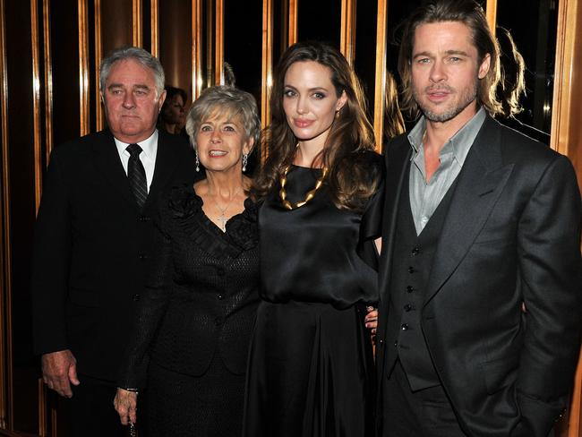 Angelina Jolie and Brad Pitt with Pitt's parents in New York in December 2011. Picture: Stephen Lovekin/Getty Images