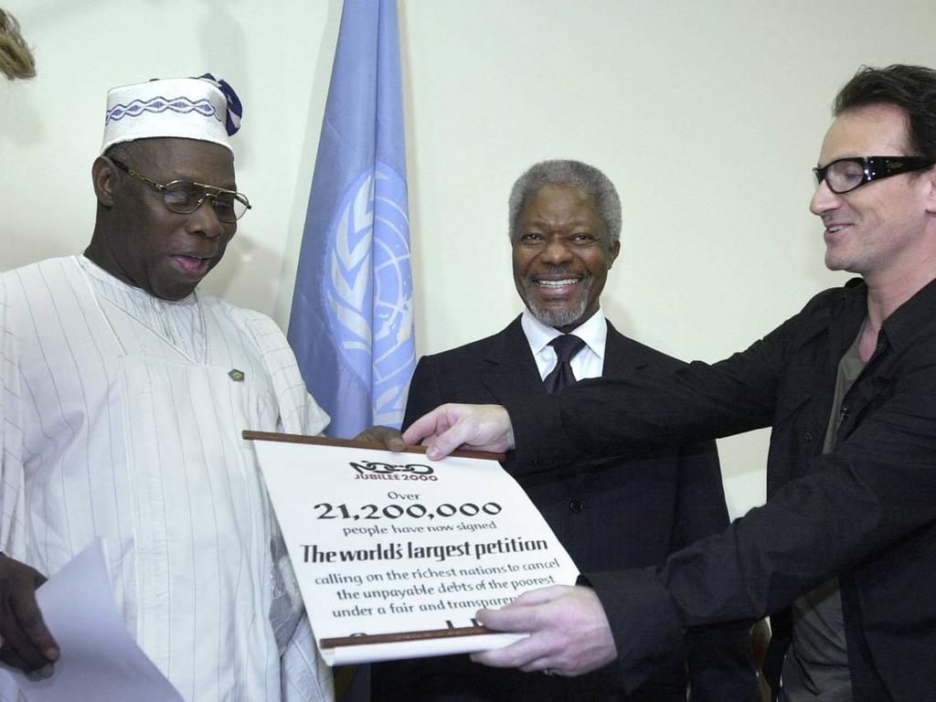 U2 frontman Bono with Nigerian President Olusegun Obasanjo and former United Nations Secretary-General Kofi Annan at a UN summit in 2000. Picture: Getty