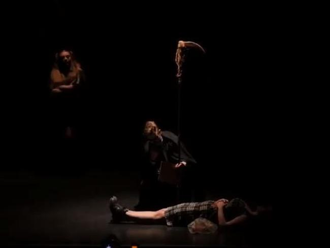 Ms Dixon lies on the floor in the beginning of the scene as Death looks over her.