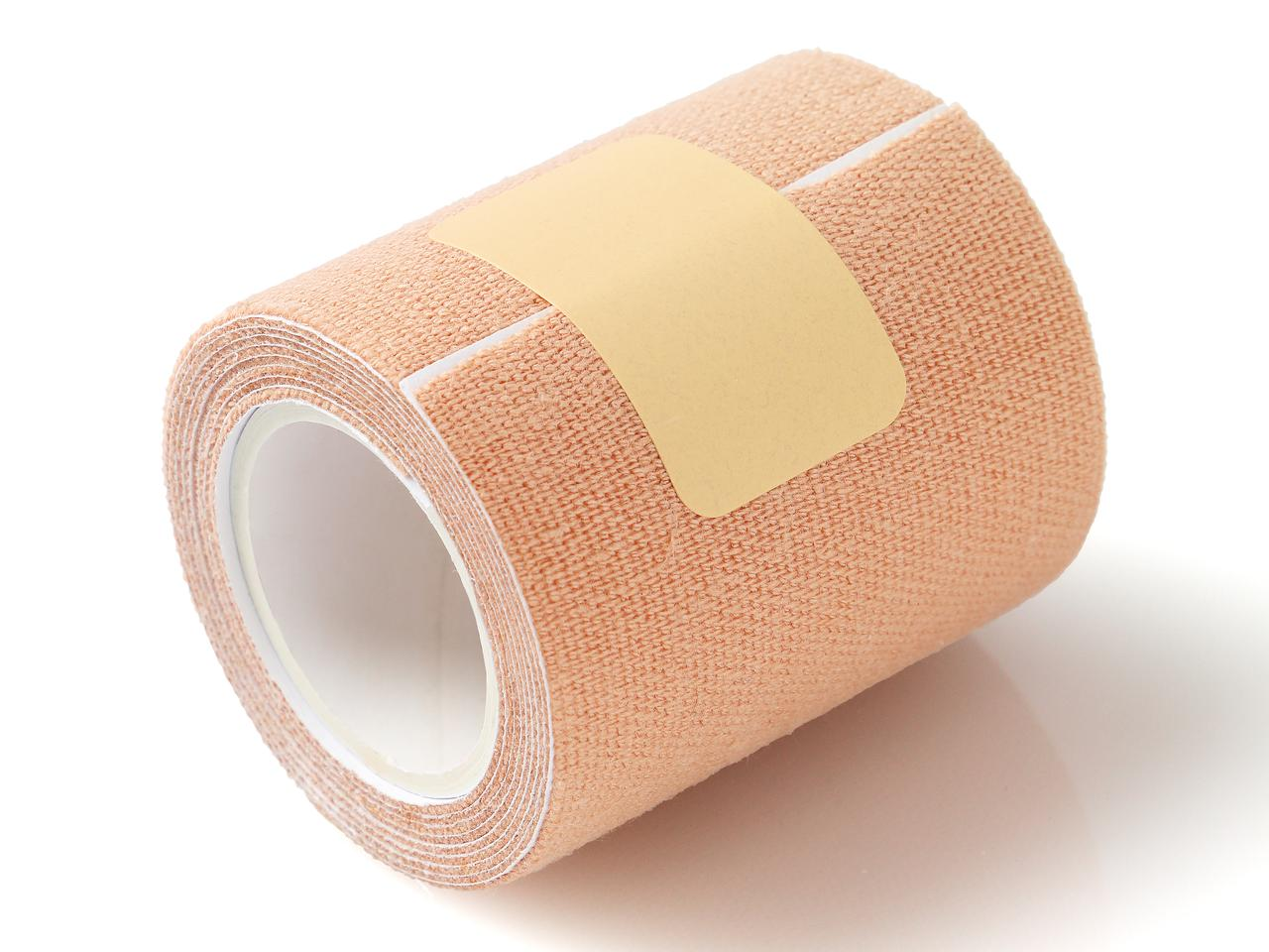 Roll of Elastic Therapeutic Tape on White Background