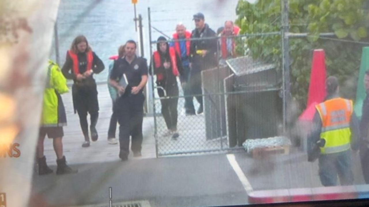 A Sky News camera crew captures the moment the passengers make it back to shore.