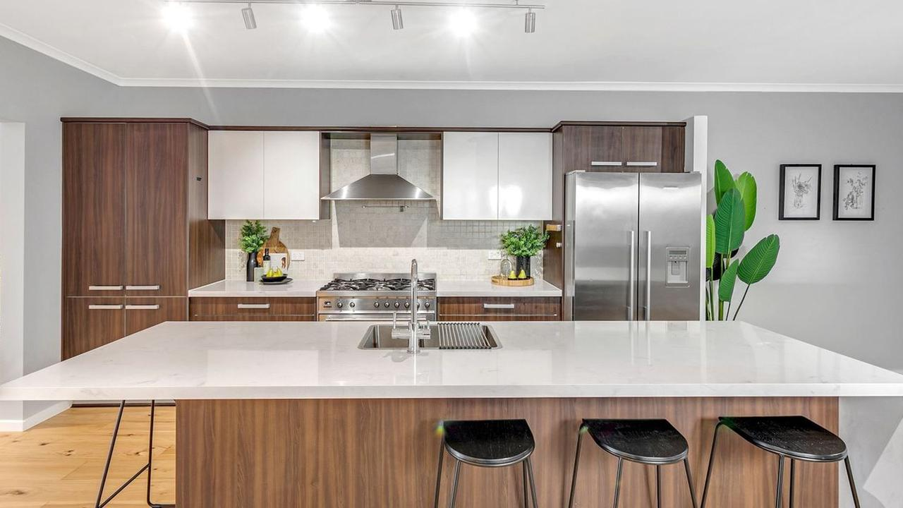 It has an open kitchen, living and dining area. Pic: realestate.com.au