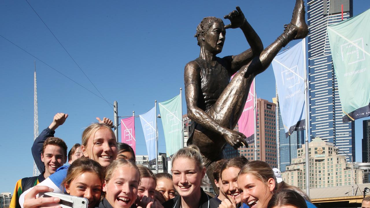AFLW star Tayla Harris gets a selfie with fans at the unveiling of a prototype statue that will be made to recognise her achievements in women's football at Federation Square, Melbourne, Victoria, September 11, 2019. Picture: AAP