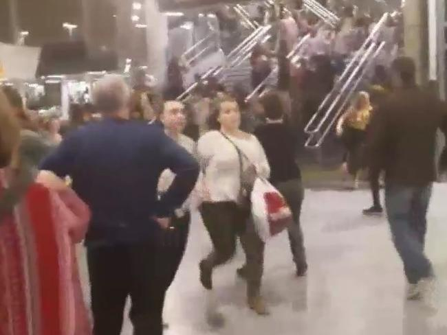 Concert goers are seen escaping the main arena after an explosion at an Ariana Grande concert in Manchester. Picture: Supplied