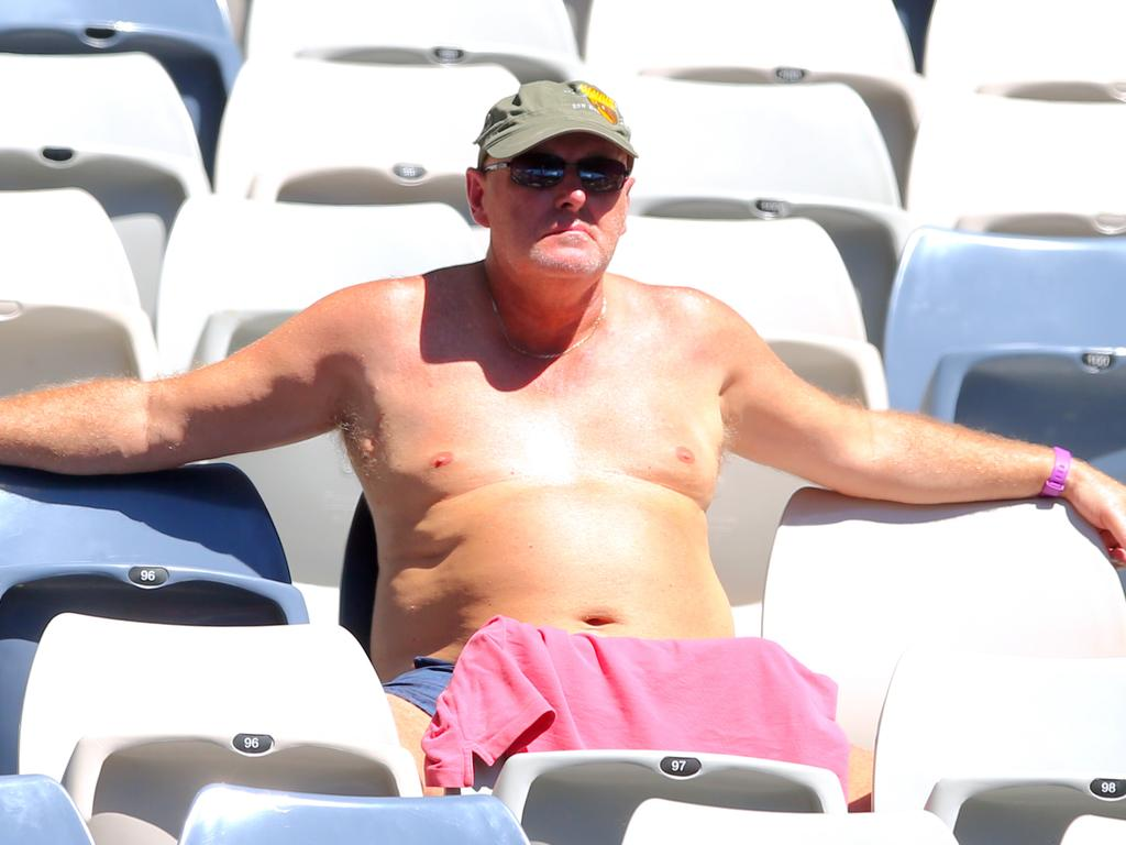 A spectator enjoys the warm weather during an Australian Open at Melbourne Park.The heat will be on again this week. Picture: David Crosling
