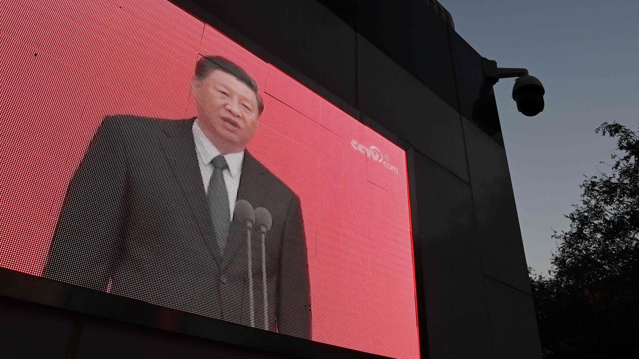Chinese President Xi Jinping on a TV screen shortly after announcing the new five-year plan. Picture: GREG BAKER / AFP.