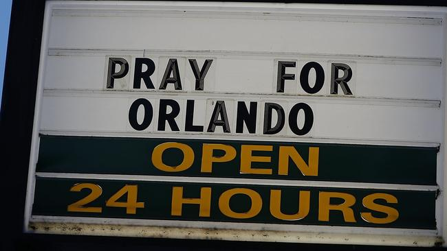 """A sign reading """" Pray for Orlando"""" is seen near the Pulse gay nightclub. Picture: AFP"""